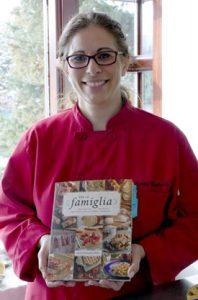 Emily Richards with her  book Per La Famiglia